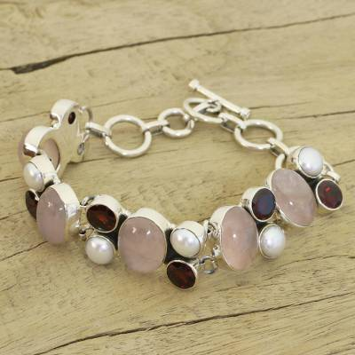 Pearl and rose quartz charm bracelet, 'A Spell of Romance' - Pearl Rose Quartz and Garnet Bracelet from India