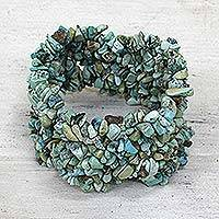 Turquoise stretch bracelet, 'Skylark' - Natural Turquoise Stretch Bracelet India Beaded Jewelry