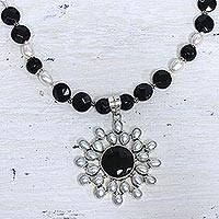 Pearl and onyx flower necklace, 'Facets' - Pearl and Onyx Sterling Silver Necklace with Pendant.