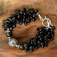 Onyx torsade bracelet, 'Midnight Tears' - Artisan Crafted Black Onyx Torsade Bracelet with Silver