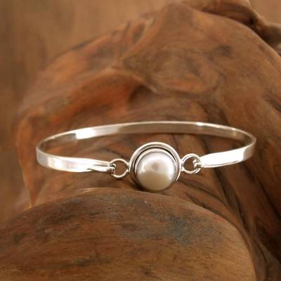 Pearl bangle bracelet, 'Aesthetic Moon' - Handcrafted Indian Sterling Silver Bangle Pearl Bracelet