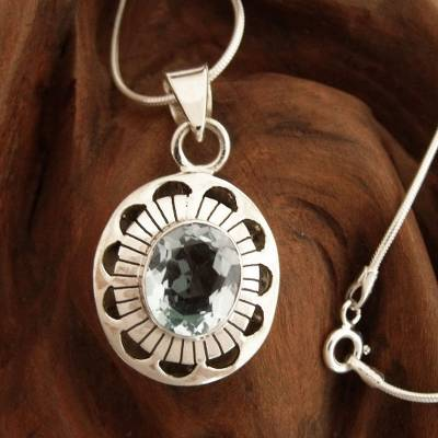 Blue topaz pendant necklace, 'Sky Halo' - Sterling Silver with Blue Topaz Floral Necklace Jewelry