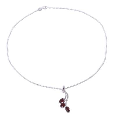 Garnet pendant necklace, 'Shooting Stars' - Hand Made Sterling Silver and Garnet Necklace