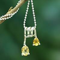 Citrine pendant necklace, 'Hypnotic Fantasy' - Handmade Sterling Silver and Citrine Necklace