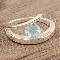 Blue topaz solitaire ring, 'Dazzling Love'