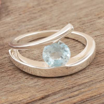 Blue topaz solitaire ring, 'Dazzling Love' - Sterling Silver Solitaire Blue Topaz Ring