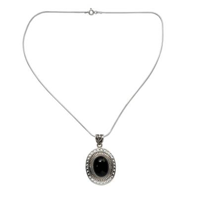 Onyx pendant necklace, 'Tribal Medallion' - Handmade Sterling Silver and Onyx Necklace from India
