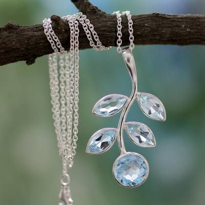 Blue topaz pendant necklace, 'Azure Leaves' - Unique Blue Topaz and Sterling Silver Pendant Necklace