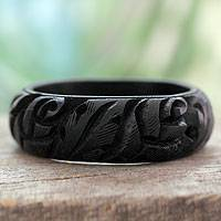 Wood bangle bracelet, 'Black Rose Garland' - Wood bangle bracelet