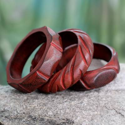 Wood bangle bracelets, 'Indian Romance' (set of 3) - Hand Carved Mango Wood Bangle Bracelets India (Set of 3)