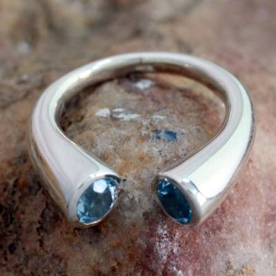 Blue topaz wrap ring, 'Face to Face' - Blue Topaz Ring 2 Cts Sterling Silver from India