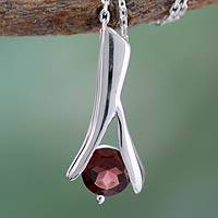 Garnet pendant necklace, 'Silver Flare' - Hand Crafted Sterling Silver and Garnet Pendant Necklace