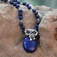 Lapis lazuli pendant necklace, 'Lovely Lily' - Lapis Lazuli Necklace with Unique Silver Floral Accent