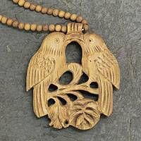 Wood pendant necklace, 'Courtship' - Wood Beaded Bird Necklace from India