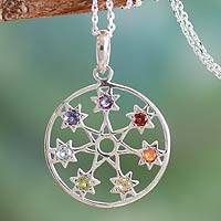 Garnet and amethyst pendant necklace, 'Chakra Stars' - Fair Trade 7 Stone Silver Chakra Necklace