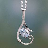Blue topaz pendant necklace, 'Flow' - Fair Trade Sterling Silver and Blue Topaz Necklace