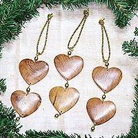 Wood ornaments, 'Cheerful Hearts' (set of 3) - Fair Trade Hand-carved Wood Ornaments (set of 3)