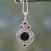 Onyx and garnet pendant necklace, 'Delhi Hope' - Fair Trade Onyx and Garnet Sterling Silver Necklace