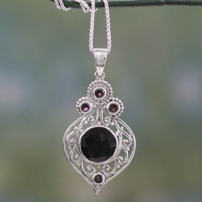 Onyx and garnet pendant necklace, 'Delhi Hope' - Fair Trade Onyx and Garnet Sterling Silver Necklace