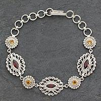 Garnet and citrine link bracelet, 'Andaman Fern Forest' - Ornate Silver Jali Bracelet with Faceted Garnets and Citrine