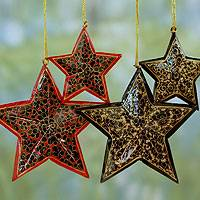 Wood Christmas ornaments, 'Midnight Blossoms' (set of 4) - Hand Painted Black Wood Star Christmas Ornaments (Set of 4)