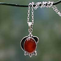 Carnelian pendant necklace, 'Solar Charm' - Sterling Silver and Carnelian Pendant Necklace from India