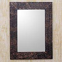 Aluminum repousse wall mirror, 'Twirling Flowers' - Antiqued Copper Color Mirror Frame with Embossed Flowers