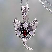 Rainbow moonstone and garnet pendant necklace, 'Butterfly Triumph' - Silver Butterfly with Garnet and Rainbow Moonstone