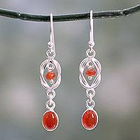 Onyx dangle earrings, 'Festive Red Knot' - Artisan Crafted Sterling Silver and Red Onyx Dangle Earrings