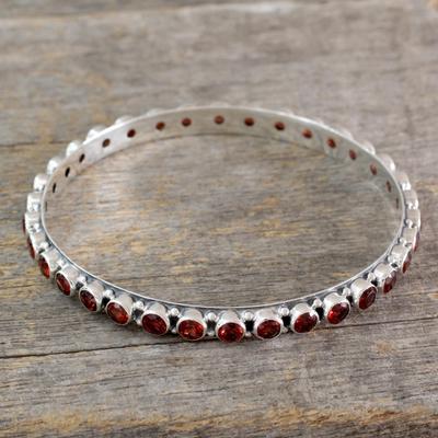 Garnet bangle bracelet, 'Love's Energy' - 15-carat Garnet Fair Trade Silver Bangle Bracelet from India