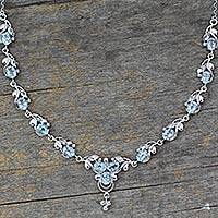 Blue topaz pendant necklace, 'Mumbai Garland' - Sterling Silver Necklace with Blue Topaz Blossoms 20 Carats