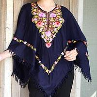 Wool poncho, 'Royal Garden' - Dark Blue Wool Poncho with Pastel Flower Embroidery