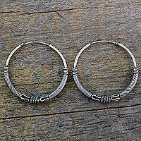 Sterling silver hoop earrings, 'Twist of Fate' - Endless Hoop Style Earrings in Sterling Silver from India