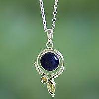 Lapis lazuli and citrine pendant necklace, 'Enigmatic Glow' - Handcrafted Lapis and Citrine Sterling Silver Necklace