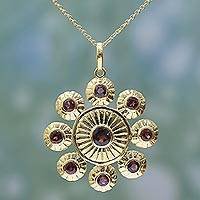 Gold plated garnet pendant necklace, 'Floral Brilliance' - Gold Plated Sterling Silver and Garnet Pendant Necklace
