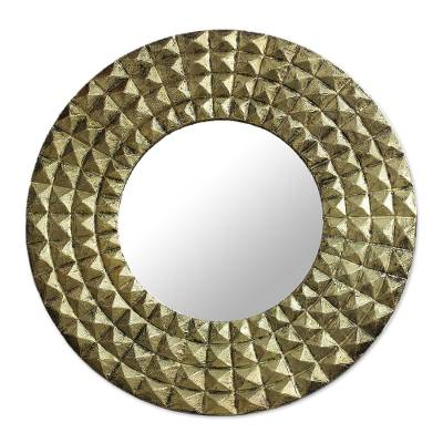 Brass wall mirror, 'Circling Pyramids' - Antiqued Embossed Brass Circular Wall Mirror from India