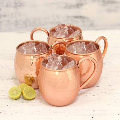 Copper mugs, 'Friendly Celebration' (set of 4) - Set of Four Handcrafted Copper Drinking Mugs from India