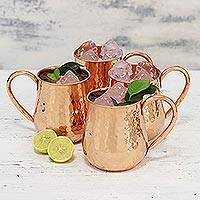 Copper mugs, 'Friends Reunited' (set of 4) - Set of Four Hand Crafted Shiny Copper Mugs from India