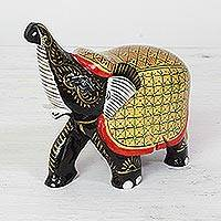 Wood figurine, 'Elephant Fortune' - Handcrafted Black Elephant Wood Figurine with Golden Coat