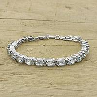 Blue topaz tennis bracelet, 'Blue Holiday' - Blue Topaz and Sterling Silver Indian Tennis-Style Bracelet