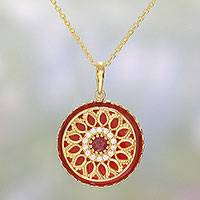 Gold plated garnet and onyx pendant necklace, 'Petal Grandeur in Red' - Gold Plated Garnet and Onyx Pendant Necklace from India