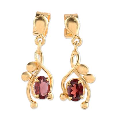 Gold plated garnet dangle earrings, 'Red Twist' - 22k Gold Plated Garnet Dangle Earrings by Indian Artisans