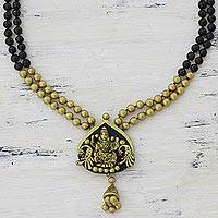 Ceramic pendant necklace, 'Beautiful Lakshmi' - Gold Tone and Black Ceramic Pendant Necklace of Lakshmi
