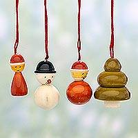 Wood ornaments, 'Jolly Christmas' (set of 4) - Set of Four Wood Christmas Ornaments by Indian Artisans