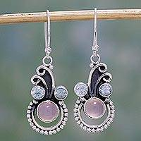 Blue topaz and chalcedony dangle earrings, 'Spiral Burst' - Blue Topaz and Chalcedony Dangle Earrings by Indian Artisans