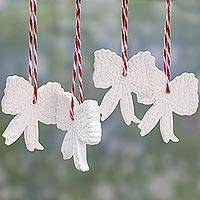 Porcelain ornaments, 'Festive Delight' (set of 4) - White Porcelain Bow Ornaments from India (Set of 4)