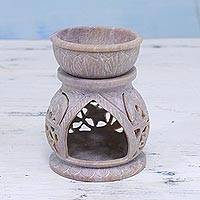 Soapstone oil warmer, 'Elephant Stroll' - Handcrafted Elephant Soapstone Oil Warmer from India
