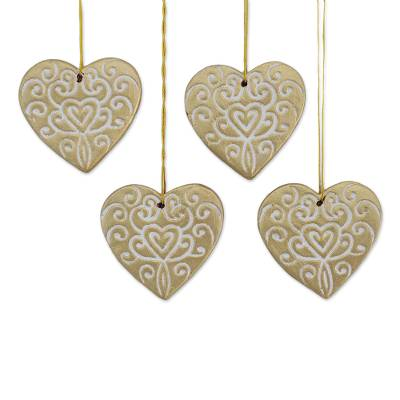 four handcrafted ceramic heart ornaments in gold christmas hearts