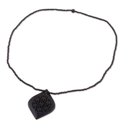 Ebony wood pendant necklace, 'Mughal Delight' - Beaded Ebony Wood Necklace with Hand Carved Leaf Pendant