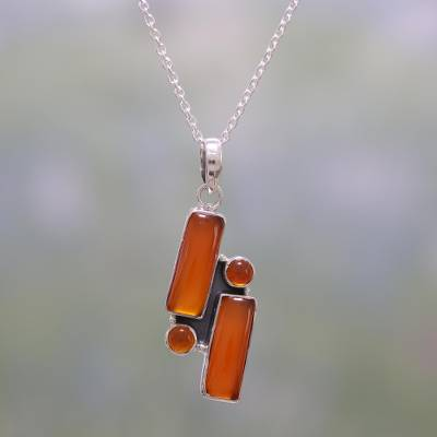 Carnelian pendant necklace, 'Orange Allure' - Carnelian and Sterling Silver Pendant Necklace from India